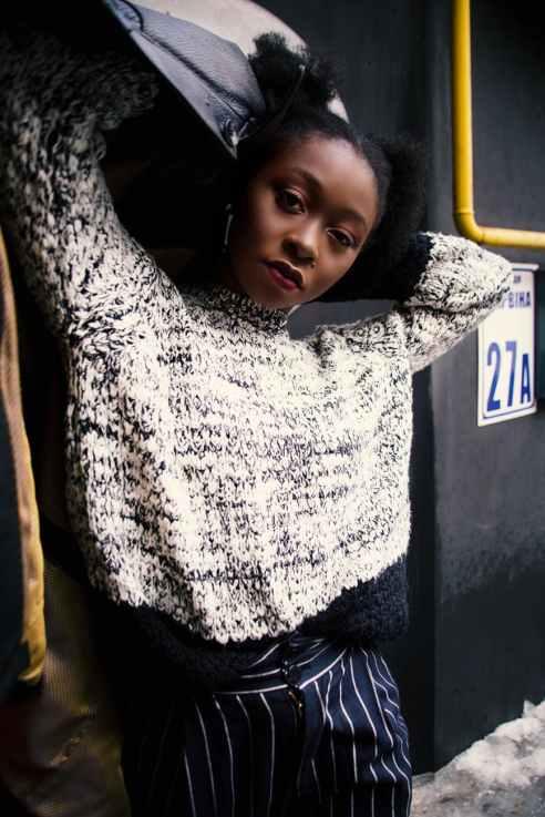 photo of woman gray sweater