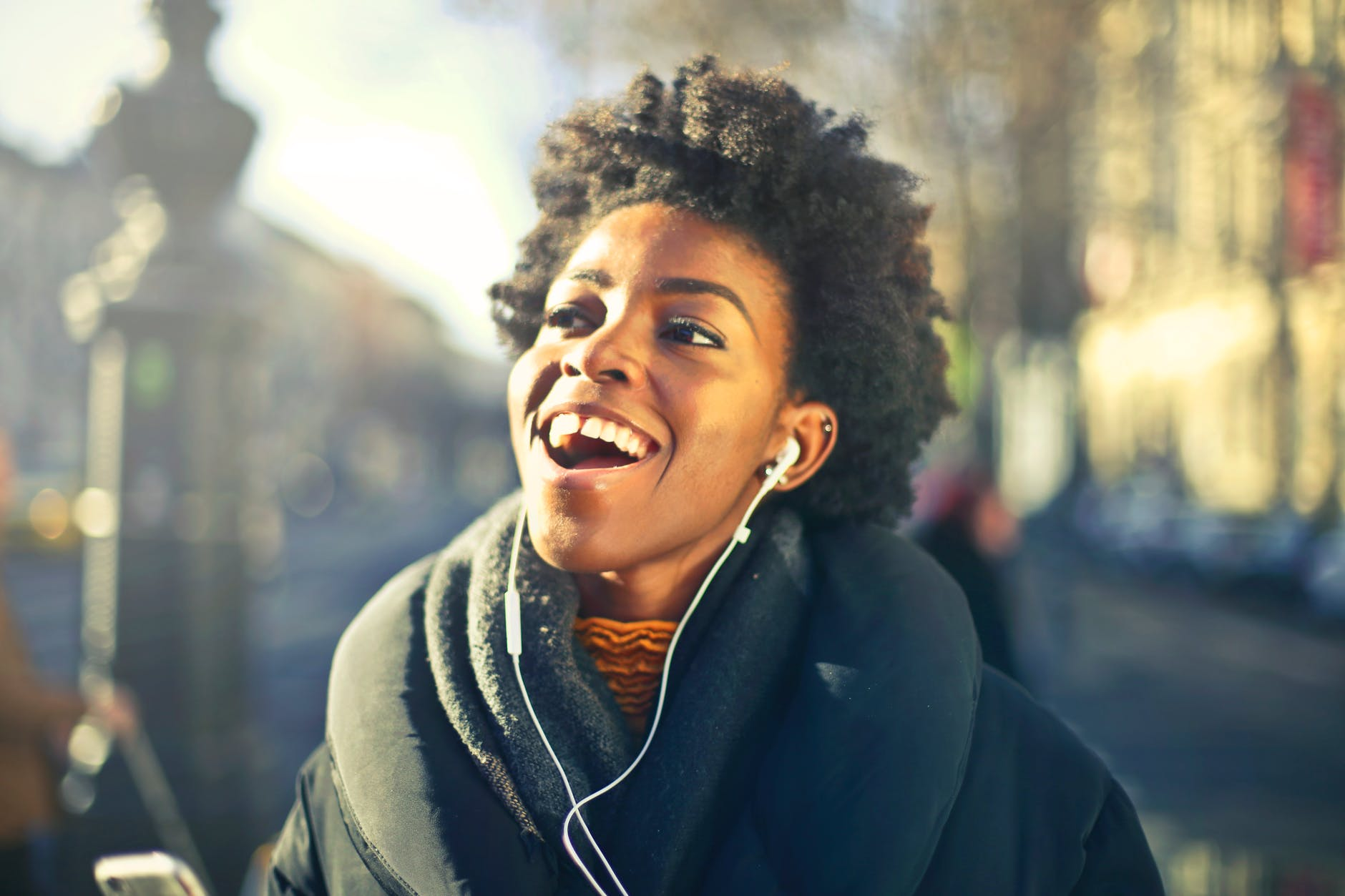close up photo of a woman listening to music