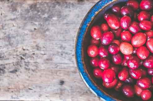 bowl of red round fruits