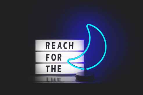 reach for the and blue moon neon signages
