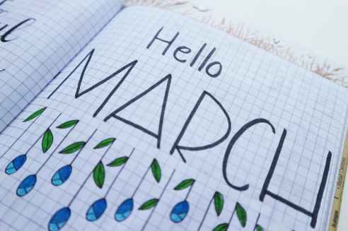 hello march printed paper on white surface